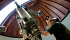 Father Emmanuel Carreira operates the telescope at the Vatican Observatory in Castelgandolfo, south of Rome, June 23, 2005. In the sleepy lakeside village of Castelgandolfo, away from the noise and haste of Rome, the Vatican is helping to train tomorrow's astronomers, regardless of their religious beliefs. For the past 20 years, the Vatican Observatory, one of the world's oldest astronomical institutes, has selected young, promising scholars for courses at the papal summer palace. Picture taken June 23, 2005. - RTXNKY9
